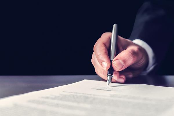 Pen signing paper